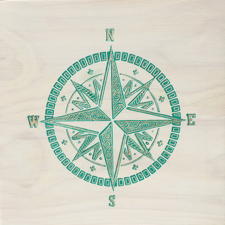 Carved wood art compass rose surfbird studio